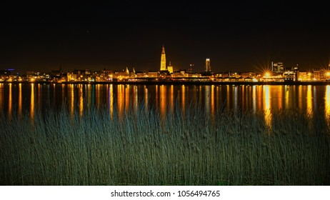 A beautiful view of the skyline of Antwerp. This cityscape offers the view together with the vegetation near the Scheldt.