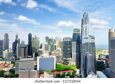 Beautiful view of skyscrapers and other modern buildings in downtown of Singapore on blue sky background. Scenic summer cityscape. Singapore is a popular tourist destination of Asia.