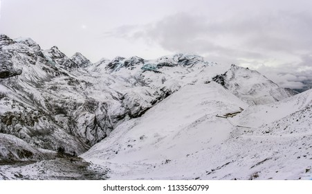Beautiful view of the snow-covered camp at the Thorong La pass on a cloudy day, Nepal.