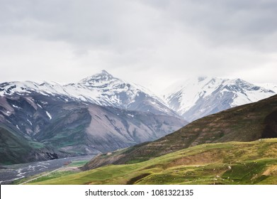 Beautiful view of the snow-covered and vegetated Caucasus Mountains