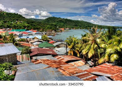 Beautiful view of some rusty tin roof tops overlooking Lake Taal, Philippines.