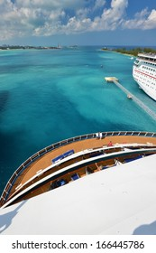 Beautiful view from stern of big cruise ship docked in Nassau - Bahamas.