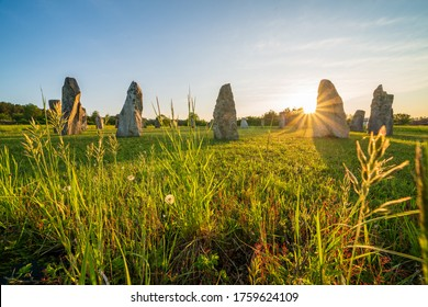 Beautiful view of Stonehenge in historical village Holasovice, the Czech Republic. Stone circles with grass in foreground at sunset. Famous tourist destination.