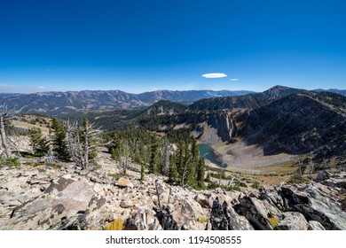 Beautiful view from the summit of mountains in the Bridger Teton National Forest near Jackson Wyoming, featuring a small alpine lake. Autumn season