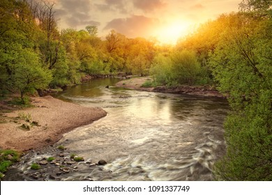 beautiful view of the sun and the river