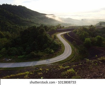 A beautiful view of sunrise in the hill and road on the morning