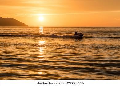 Beautiful view of sunset at Batu Ferringhi Beach, Penang Island, Malaysia.