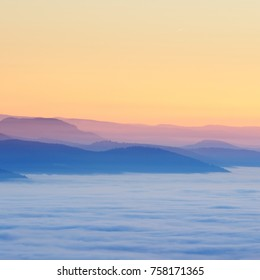 Beautiful view of the sunset in the mountains and valleys with fog. French Alsace, Vosges mountains