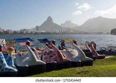 Beautiful view to swan paddleboats by Rodrigo de Freitas lagoon in the South Zone of Rio de Janeiro, Brazil