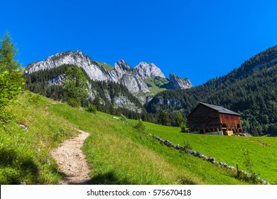Beautiful view of Swiss countryside on the hiking path toward the peak Santis (Saentis) from the valley, Canton of St. Gallen, Switzerland