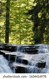 Beautiful view of Szklarka Falls in super green forest surroundings, Karkonoski National Park, Poland