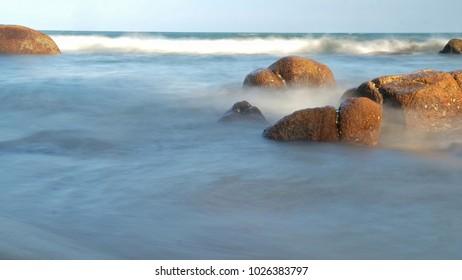 Beautiful view at Teluk Cempedak Beach, Kuantan, Pahang, Malaysia. Soft focus due to long exposure photography.