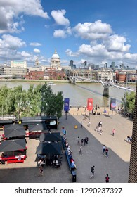 Beautiful view of Thames river, Millennium Bridge and St. Paul cathedral from the terrace of the Tate  Modern art museum in London, UK 20/08/2018