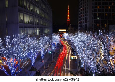 A beautiful view of Tokyo Tower with decorative Chrsitmas lighting and light trail from traffic in the foreground, taken from Roppongi Hill