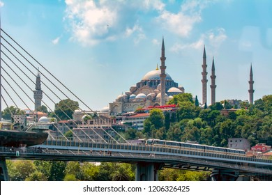 Beautiful View touristic landmarks from sea voyage on Bosphorus. Cityscape of Istanbul at sunset - old mosque and turkish steamboats, view on Golden Horn.