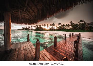 Beautiful view toward tropical beach and wooden water villa, Punta Cana
