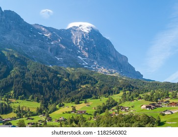 Beautiful view of the town of Grindelwald on the background of Eiger peak. Grindelwald, Switzerland, Europe