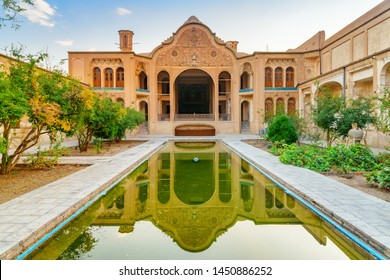 Beautiful view of traditional Iranian courtyard with garden and pool in the middle, Kashan, Iran. The Borujerdi Historical House reflected in water. Wonderful Persian architecture. Scenic exterior.
