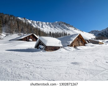 Beautiful view of traditional rustic wooden mountain chalet secluded in idyllic forest in the Alps on a cold sunny day in winter, Zauchensee, Salzburg land, Austria