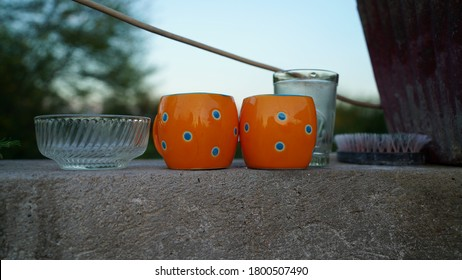 Beautiful view of transparent tumbler and ceramic glass on stone slabs. Drinking water or tea glass.