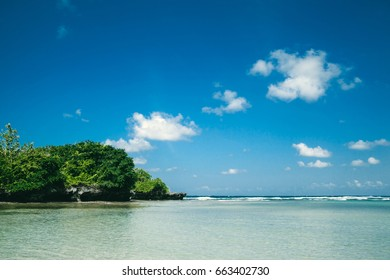 Beautiful view of tropical beach and blue sky on Bali island