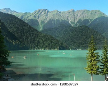 Beautiful view of the turquoise pearl of Abkhazia - Ritsa mountain lake against the background of the green Caucasus Mountains in the Ritsinsky National Relict Park
