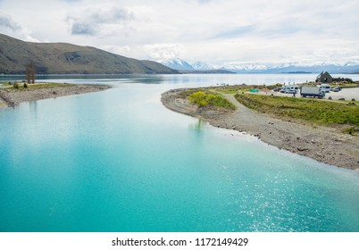 Beautiful view of turquoise water of lake Tekapo in New Zealand one of the most tourist attraction place in South island. Church of the Good Shepherd at the right side of this basin.