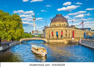 Beautiful view of UNESCO World Heritage Site Museumsinsel (Museum Island) with excursion boat on Spree river, Berlin, Germany