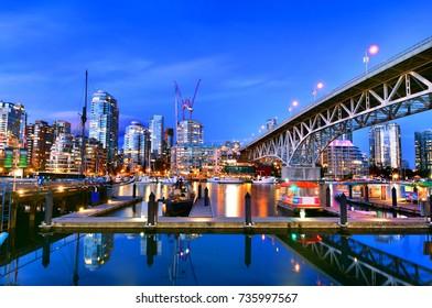 Beautiful view of Vancouver BC next to Granville Bridge along False Creek at twilight time.