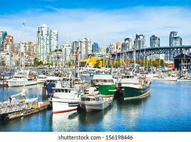 Beautiful view of Vancouver skyline with Granville bridge and ships lying in harbor at False Creek, British Columbia, Canada