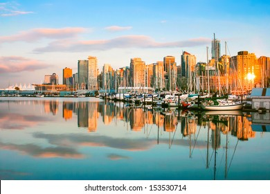 Beautiful view of Vancouver skyline with harbor at sunset, British Columbia, Canada