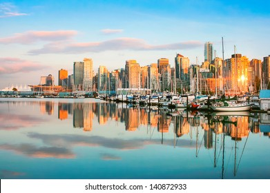 Beautiful view of Vancouver skyline with harbour at sunset, British Columbia, Canada