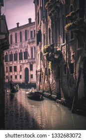 Beautiful view of Venitian canal with gondolier with his gondola - Venice (Italy)