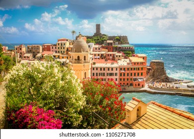 Beautiful view of Vernazza, one of the five famous fisherman villages of Cinque Terre on a sunny day with blue sky and clouds in Liguria, Italy