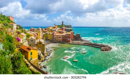 Beautiful view of Vernazza, one of the five famous fisherman villages of Cinque Terre with dramatic cloudscape in Liguria, Italy
