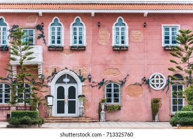 beautiful view of vintage town with white door and window on red brick wall