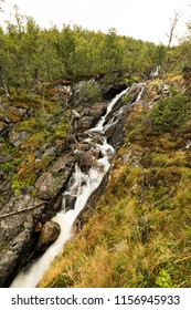 Beautiful view of the Voringsfossen waterfall. Bjoreio river. National park Hardangervidda, Eidfjord, Norway. Summer landscape in the mountains with a waterfall and fog. Foggy weather in the mountains