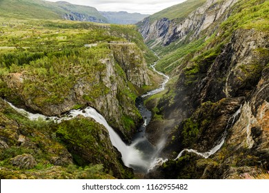 Beautiful view of the Voringsfossen waterfall. National park Hardangervidda, Eidfjord, Norway. Summer landscape in the mountains with a waterfalls. Travel around Norway. Picturesque mountain landscape
