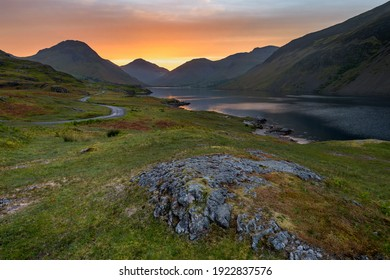 Beautiful view of Wastwater in the Lake District with Summer sunrise colour in sky. - Shutterstock ID 1922837576