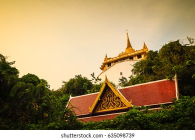 Beautiful view of Wat Saket Ratcha Wora Maha Wihan (Wat Phu Khao Thong, Golden Mount temple), a popular Bangkok tourist attraction and has become one of the symbols of the city.