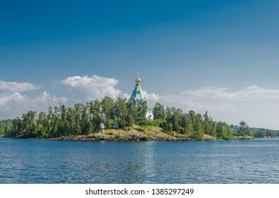 Beautiful view from the water to the island with the Orthodox Church. St. Nicholas Skete of the Valaam Monastery. Church of St. Nicholas. Karelia, Russia.