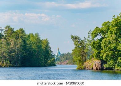 Beautiful view from the water to the island with the Orthodox Church on the horizon. St. Nicholas Skete of the Valaam Monastery. Church of St. Nicholas. Karelia, Russia.