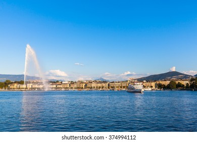 Beautiful view of the water jet fountain in the lake of Geneva and the cityscape of Geneva at sunset, Switzerland
