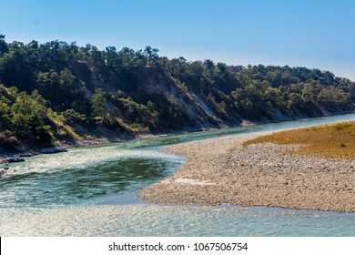 A beautiful view with water, pebbles and hills  in Manas National Park, Assam, India