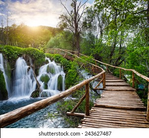 Beautiful view of waterfalls with turquoise water and sunshine in Plitvice Lakes National Park.