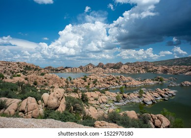 Beautiful view of Watkins Lake in Prescott Arizona. Man-made reservoir is surrounded by hundreds of huge rock boulders