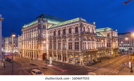 Beautiful view of Wiener Staatsoper (Vienna State Opera) aerial day to night transition timelapse in Vienna, Austria. Illuminated historic buildings and traffic on streets