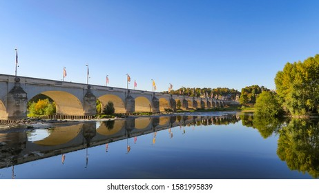 Beautiful view of the Wilson bridge and its reflection in the Loire river in Tours, France