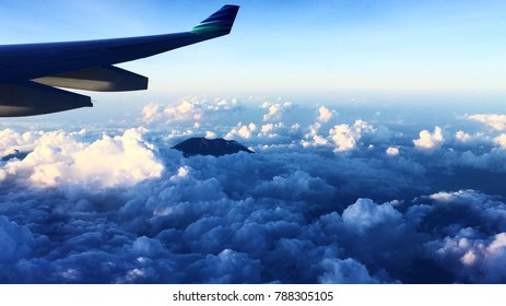 Beautiful view from the window airplane the mountain in the clouds