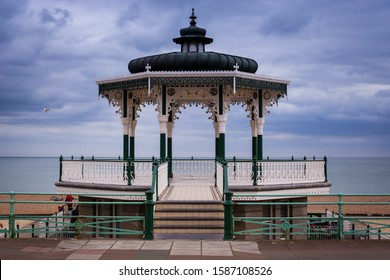 The beautiful view of the wooden pier over the sea in Brighton Bandstand, UK